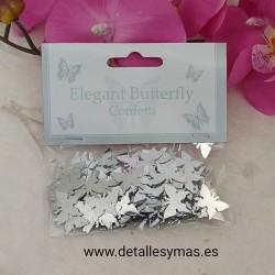Confetti de mariposa oro
